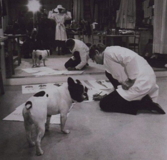 Yves Saint Laurent working with his beloved french bulldog, Moujik.